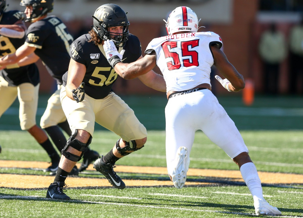 Deonte Holden battles at the line of scrimmage against Wake Forest