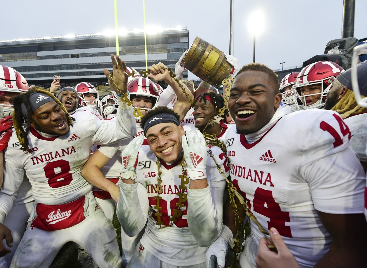 West Lafayette, IN, USA; Indiana Hoosiers players celebrate winning the Old Oaken Bucket by defeating the Purdue Boilermakers, 44-41 in 2 OT at Ross-Ade Stadium. Mandatory Credit: Thomas J. Russo-USA TODAY Sports