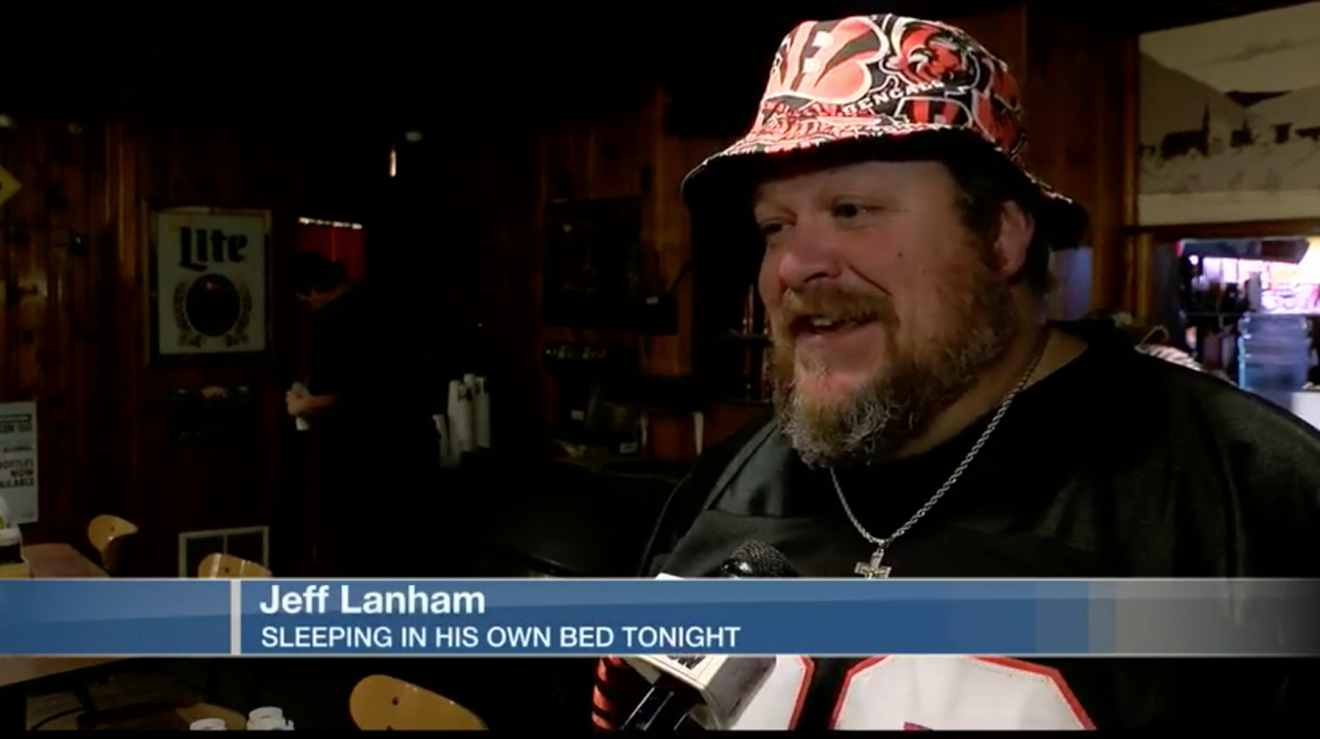 Screenshot from local news story on Bengals fan Jeff Lanham sleeping on roof