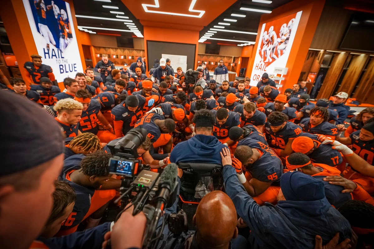 Illinois players gathering around Bobby Roundtree in the pre-game prayer before Saturday's rivalry game against Northwestern.