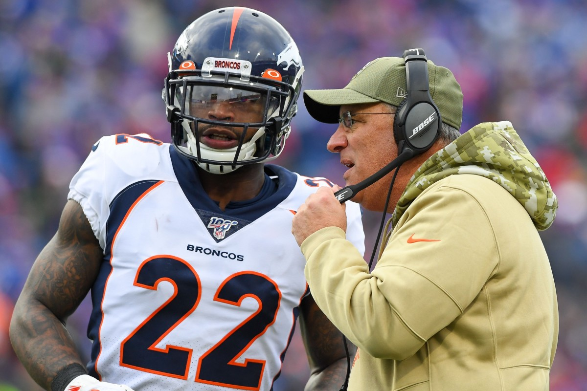 Denver Broncos head coach Vic Fangio talks with strong safety Kareem Jackson (22) during a time-out against the Buffalo Bills during the second quarter at New Era Field.