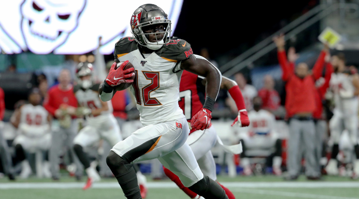 Nov 24, 2019; Atlanta, GA, USA; Tampa Bay Buccaneers wide receiver Chris Godwin (12) runs for a long touchdown catch in the first quarter against the Atlanta Falcons at Mercedes-Benz Stadium. Mandatory Credit: Jason Getz-USA TODAY Sports