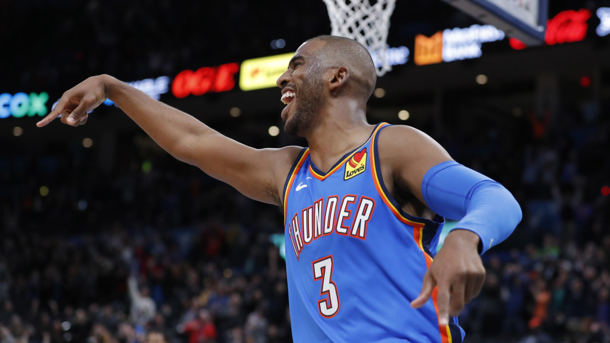 Thunder's Chris Paul signals for a delay of game vs. Timberwolves