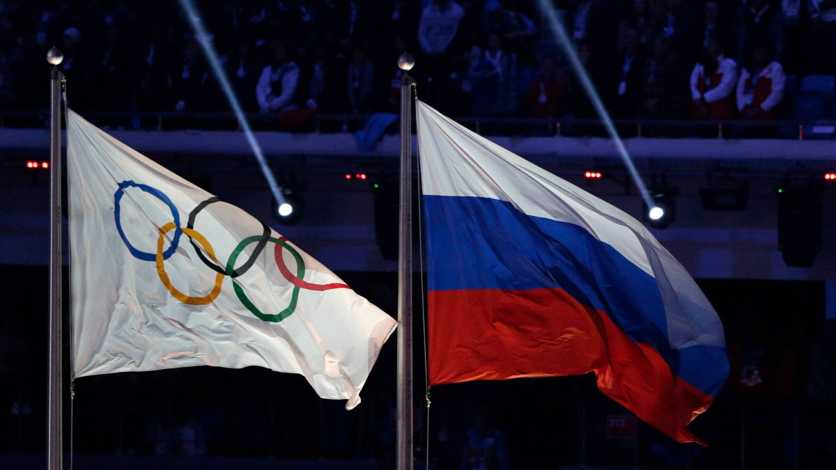 The Olympic flag next to the Russia flag.