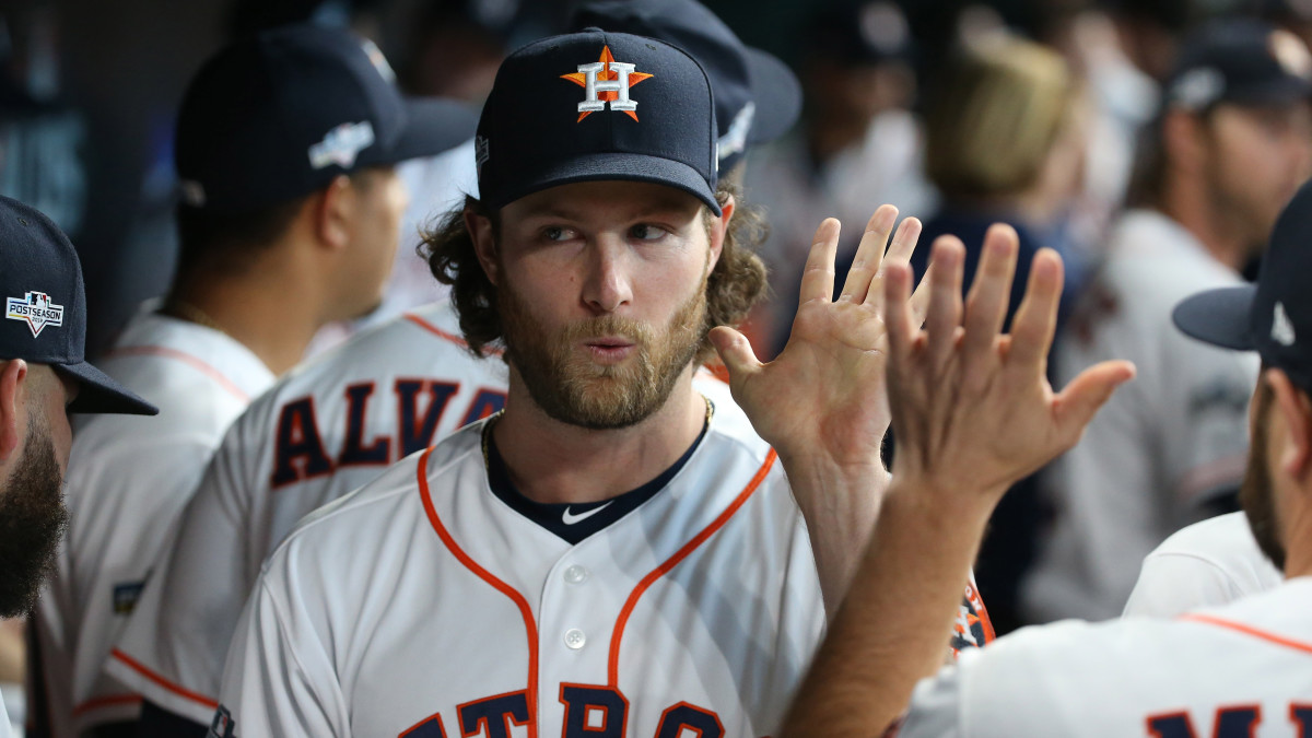 Gerrit Cole reacts in Astros dugout