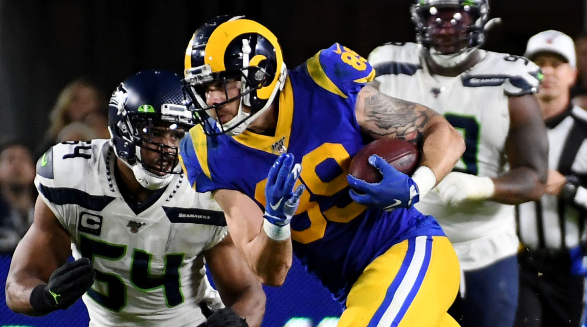 Dec 8, 2019; Los Angeles, CA, USA; Los Angeles Rams tight end Tyler Higbee (89) runs with the ball against Seattle Seahawks middle linebacker Bobby Wagner (54)  in the second half of a NFL game at Los Angeles Memorial Coliseum. Mandatory Credit: Richard Mackson-USA TODAY Sports