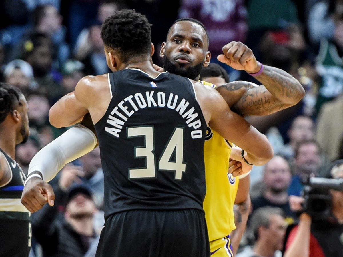 Dec 19, 2019; Milwaukee, WI, USA;  Milwaukee Bucks forward Giannis Antetokounmpo (34) gives Los Angeles Lakers forward LeBron James (23) a hug after a game at Fiserv Forum. Mandatory Credit: Benny Sieu-USA TODAY Sports