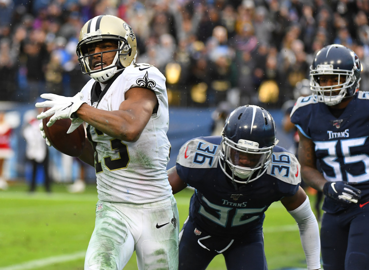 Dec 22, 2019; Nashville, Tennessee, USA; New Orleans Saints wide receiver Michael Thomas (13) breaks the record for receptions in a season with this touchdown reception during the second half against the Tennessee Titans at Nissan Stadium. Mandatory Credit: Christopher Hanewinckel-USA TODAY Sports