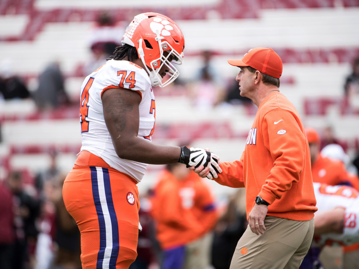 Clemson head coach Dabo Swinney shakes hands with offensive lineman John Simpson (74) before an NCAA college football game against South Carolina, in Columbia, S.C. Clemson defeated South Carolina 38-3  — 30 Nov 2019
