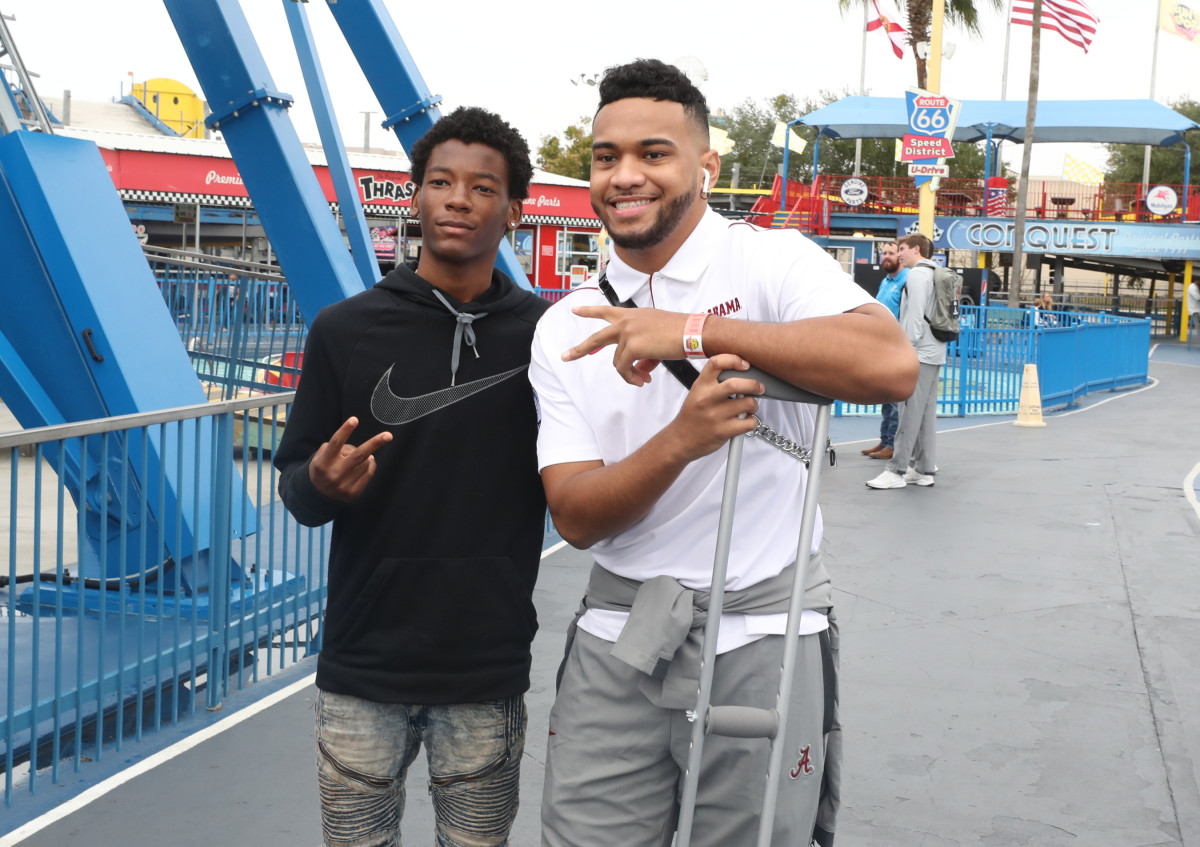 Tua Tagovailoa at Day for Kids at Fun Spot America during the Citrus Bowl trip