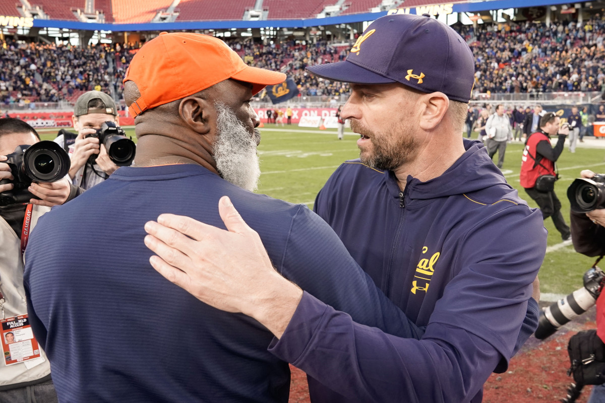 Illinois Fighting Illini head coach Lovie Smith (left) and California Golden Bears head coach Justin Wilcox after the game at Levi's Stadium.