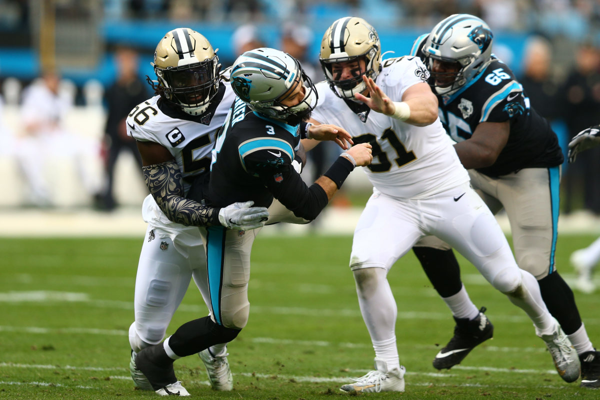 Dec 29, 2019; Charlotte, North Carolina, USA; Carolina Panthers quarterback Will Grier (3) gets hit as he passes the ball by New Orleans Saints outside linebacker Demario Davis (56) during the second quarter at Bank of America Stadium. Mandatory Credit: Jeremy Brevard-USA TODAY Sports