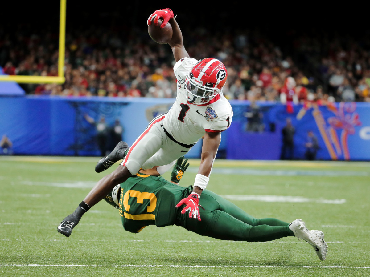 Jan 1, 2020; New Orleans, Louisiana, USA;  Georgia Bulldogs wide receiver George Pickens (1) leaps over Baylor Bears cornerback Raleigh Texada (13) during the second quarter at the Mercedes-Benz Superdome.