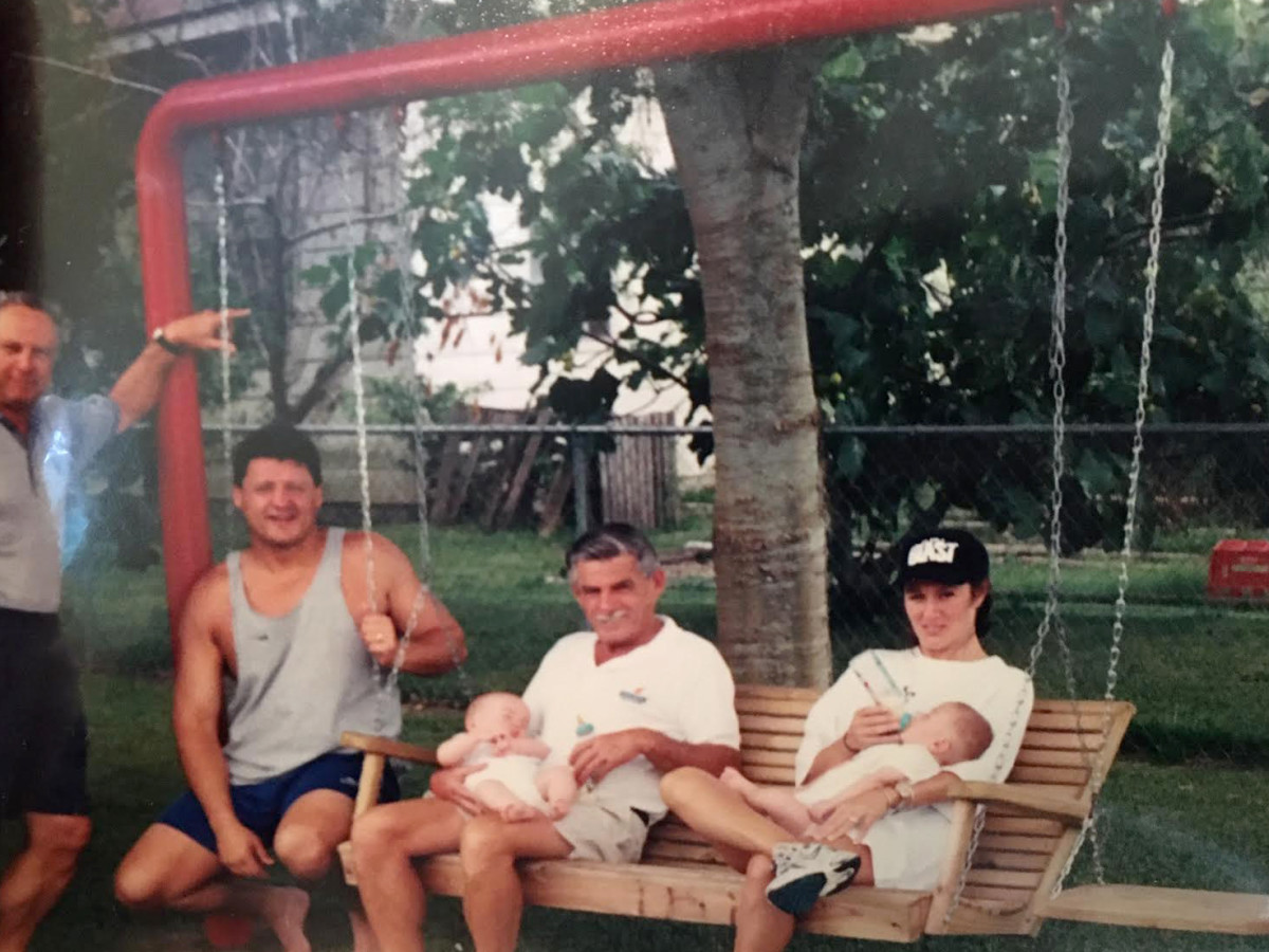 Edward Orgeron Sr. was known for sitting on his front-yard swing. He's pictured here with Edward Jr., wife Kelly and their two twin boys, Parker and Cody.