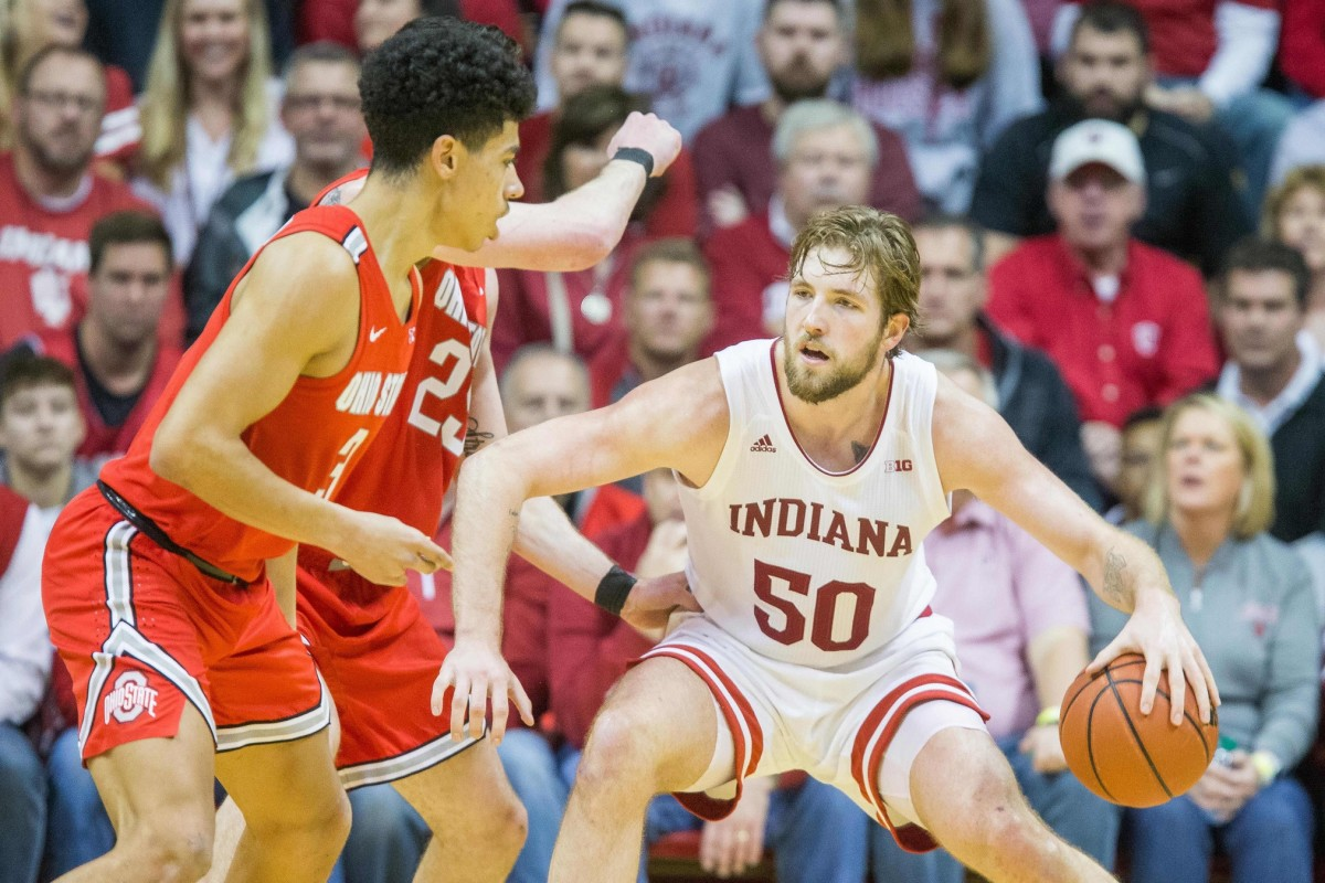 Indiana's Joey Brunk makes a move toward the basket against Ohio State defenders. (Mandatory credit: USA TODAY SPORTS)