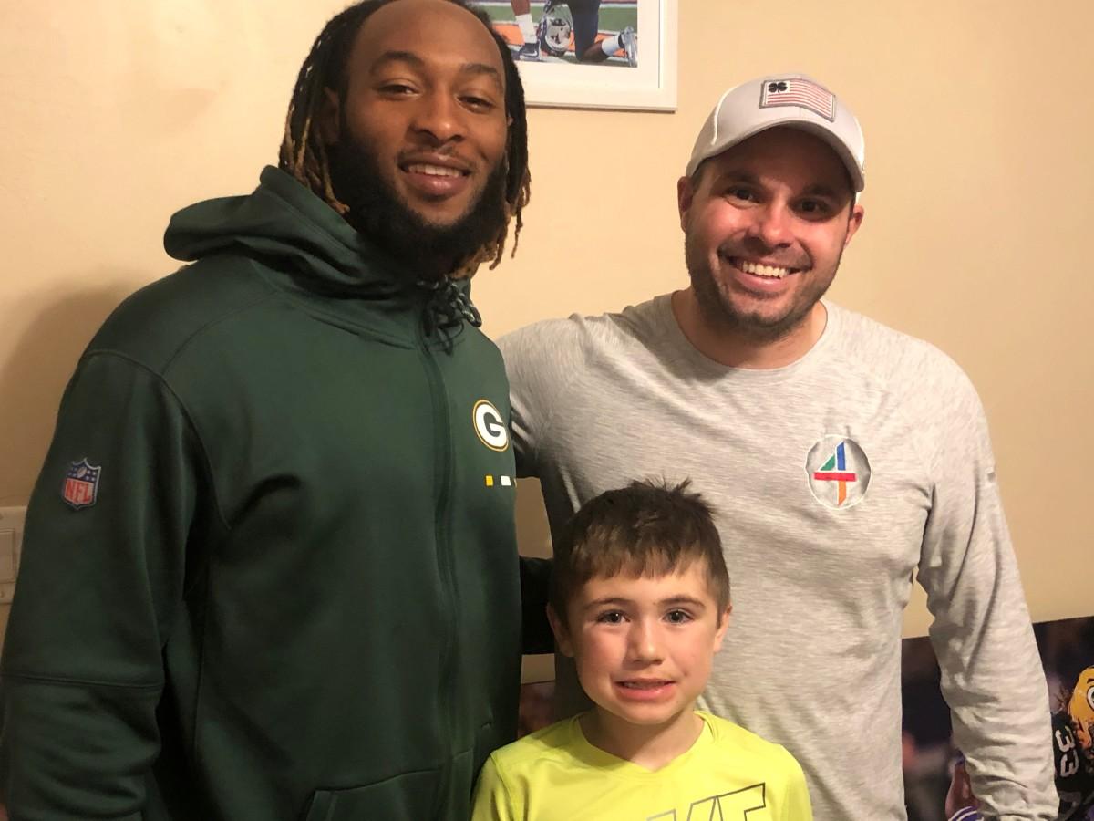 Aaron Jones, Joe Tofferi and Tofferi's son, Remi.