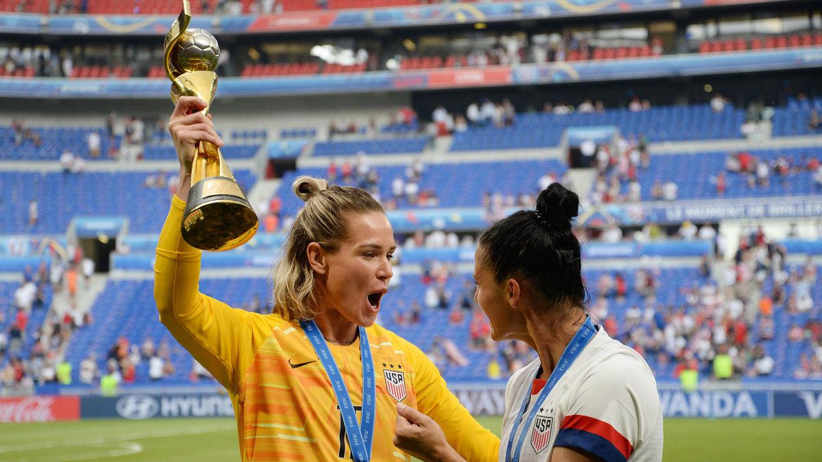 Ashlyn Harris and Ali Krieger celebrate winning the Women's World Cup