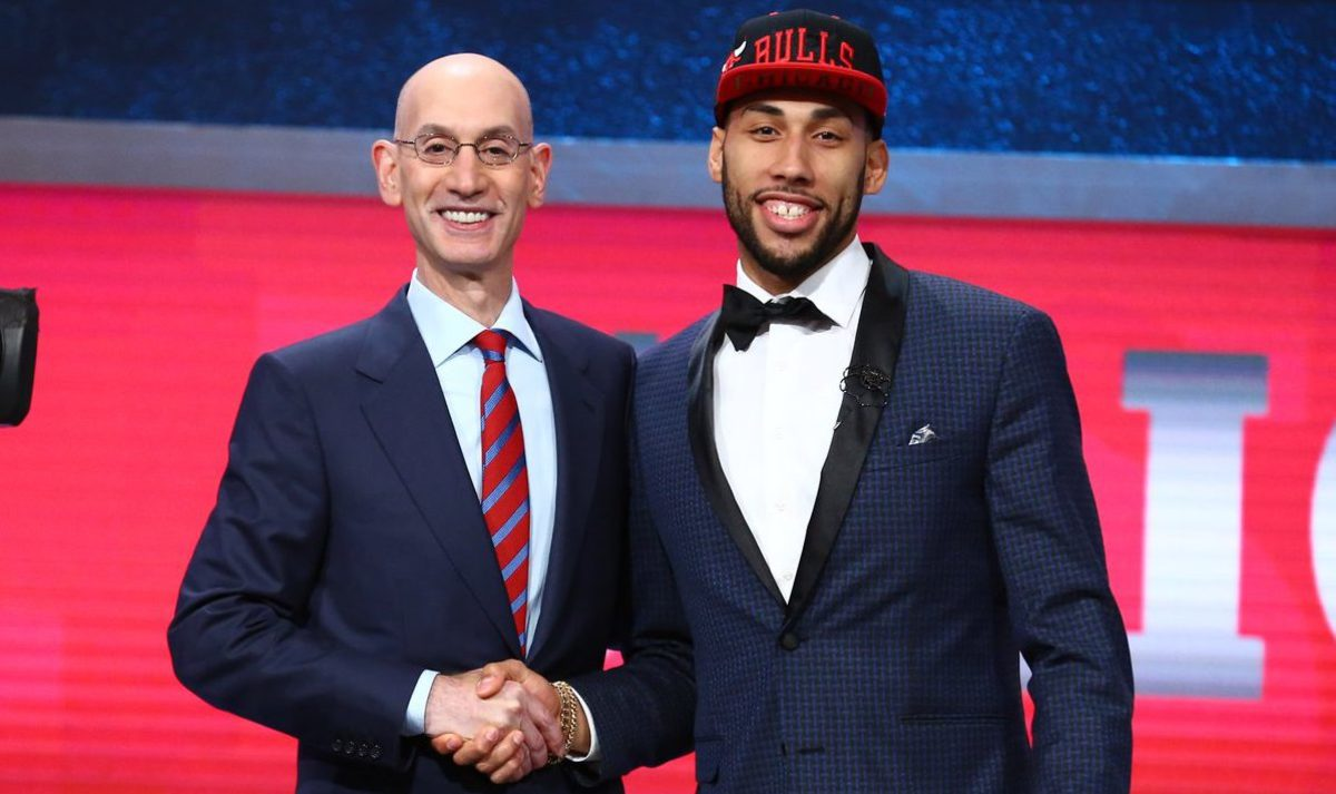 Denzel Valentine poses with the commissioner of the NBA after being selected 14th by the Chicago Bulls.  Photo courtesy of the Bulls.