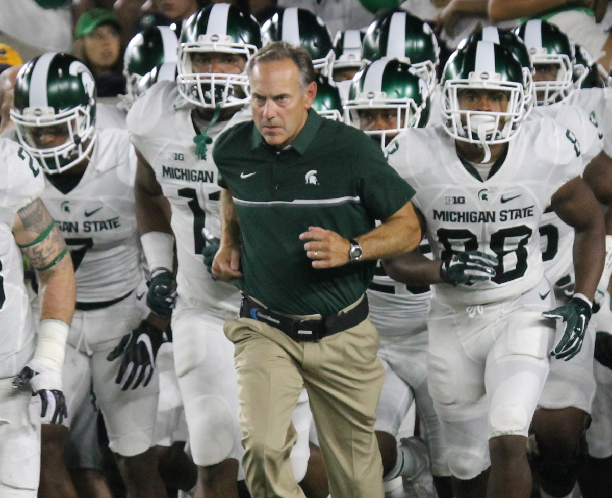 Mark Dantonio leads the Spartans out vs. Notre Dame in 2016.  Photo courtesy of Tom Ackerson.