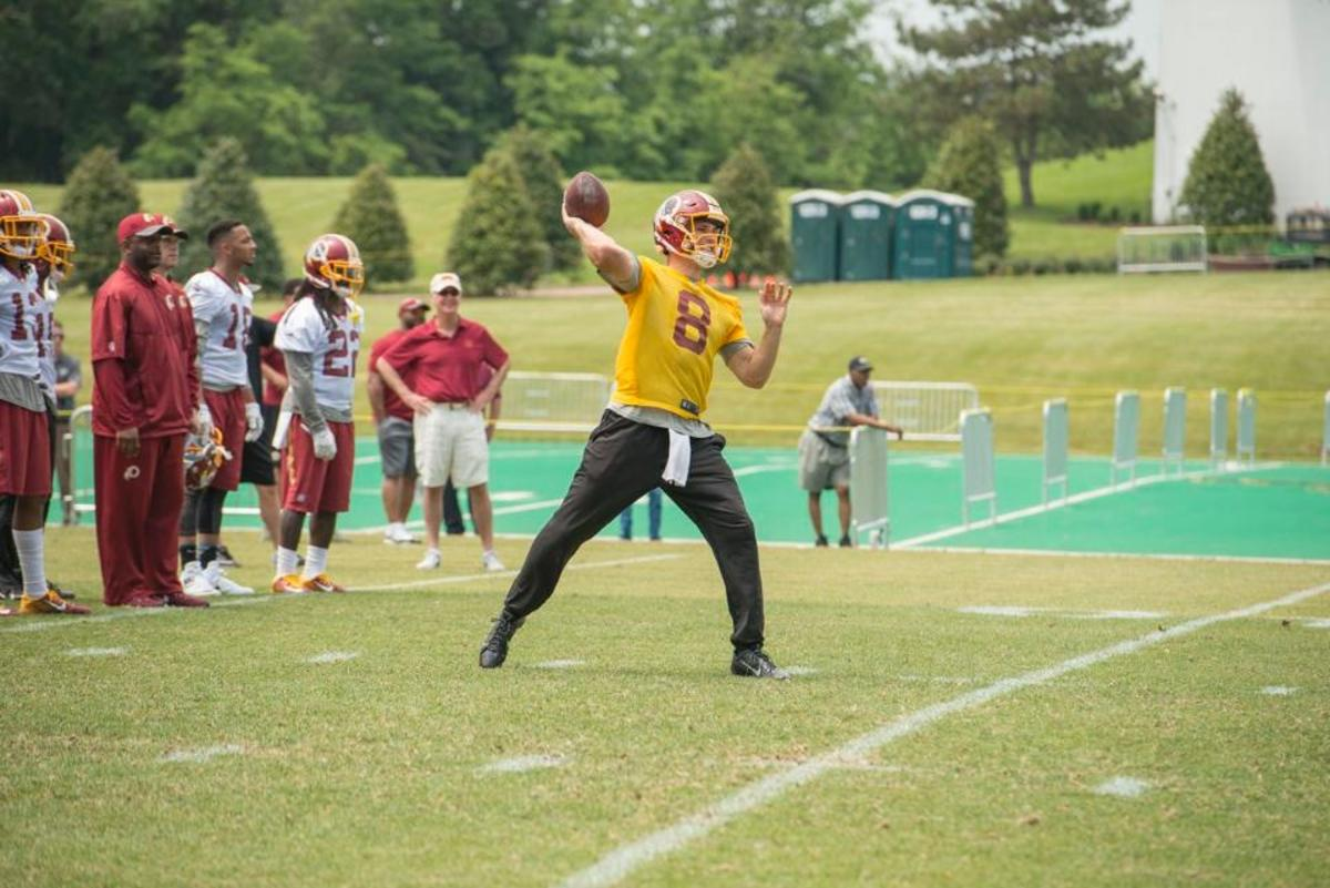 Kirk Cousins working hard on day three of the 2016 OTA for the Washington Redskins.  Photo courtesy of Redskins.com