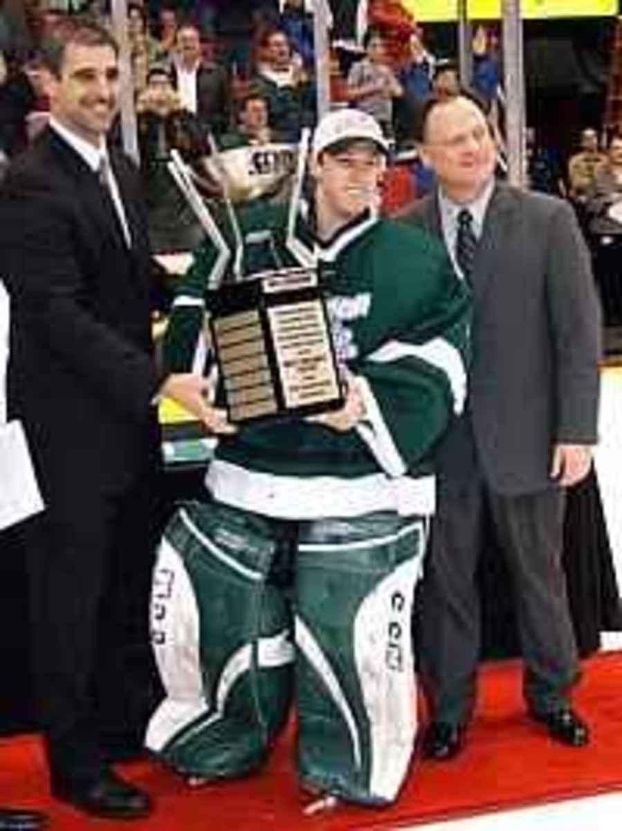 Anastos on the left is the new MSU hockey coach.