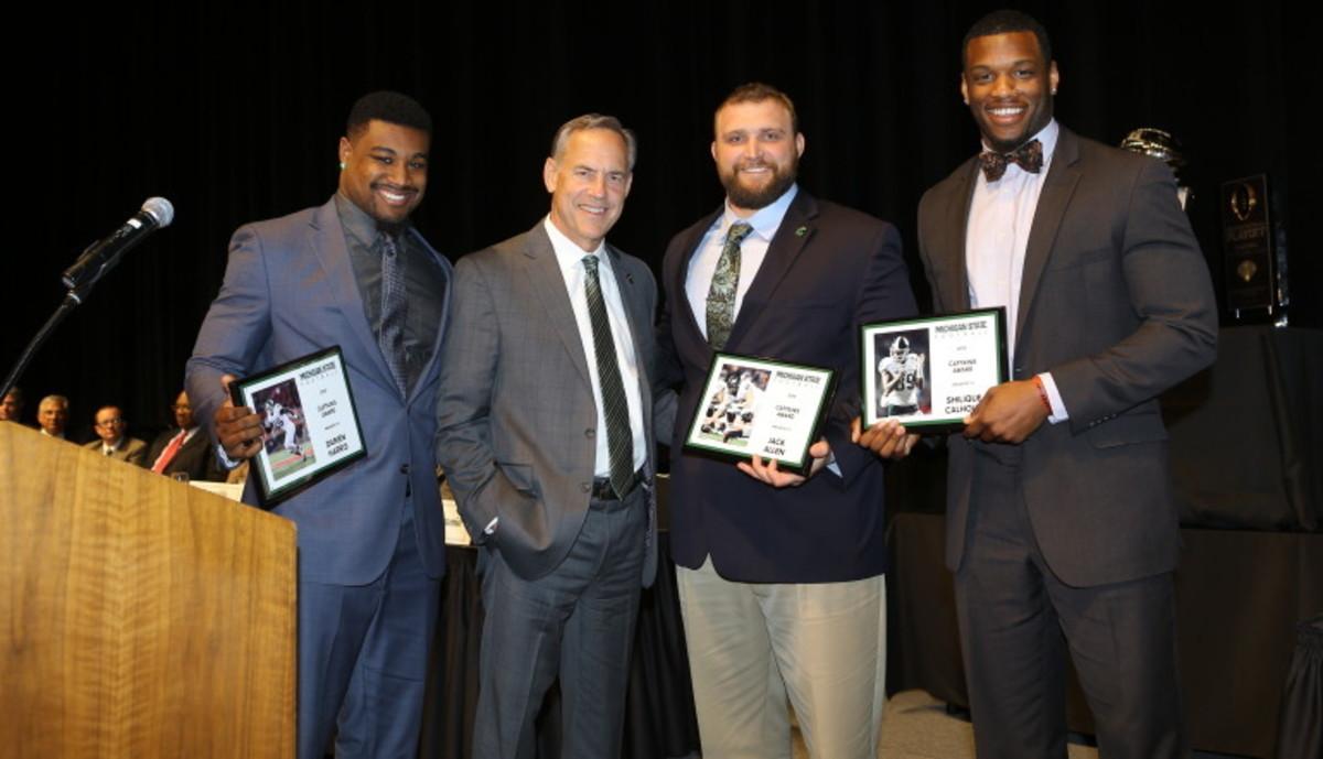 Darien Harris, Mark Dantonio, Shilique Calhoun & Jack Allen at the 2016 MSU Football awards banquet.  Photo courtesy of MSU SID.