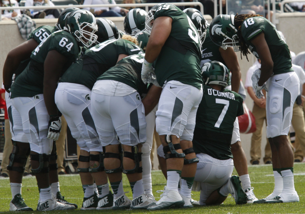 The Spartans in the huddle vs. Wisconsin 2016 photo courtesy of Starr Portice.