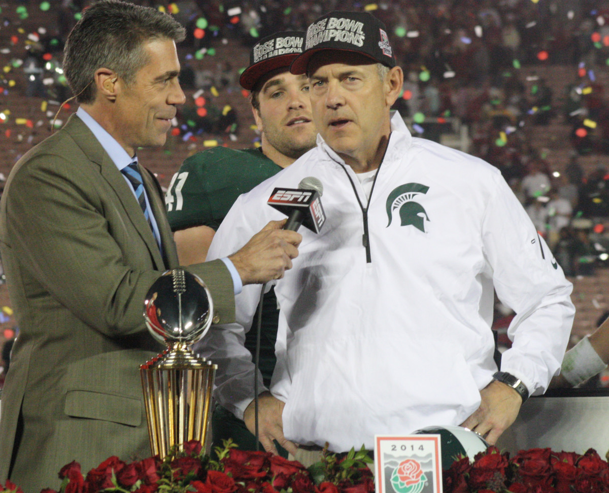 MARK DANTONIO ON STAGE AFTER WINNING THE 2014 ROSE BOWL.  PHOTO COURTESY OF MARK BOOMGAARD.
