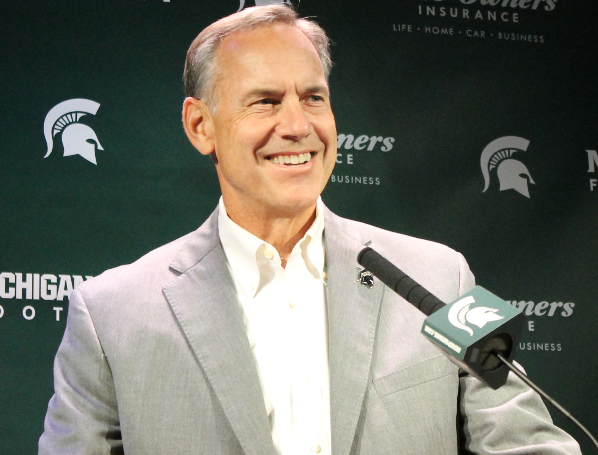 Mark Dantonio flashed a big smile while preparing for his Spartans game versus Wisconsin.