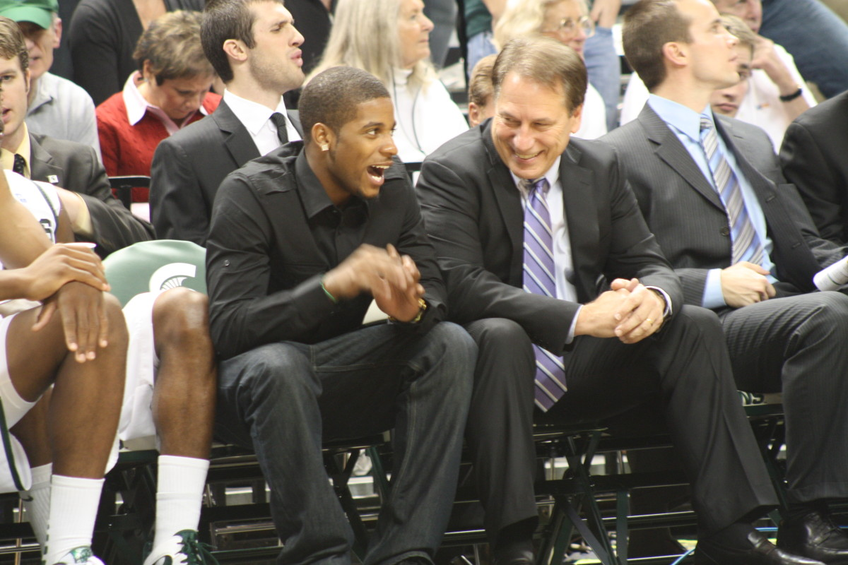 Tom Izzo took time late in the second half to joke with suspended guard Korie Lucious.  When Izzo is joking late in the second half you know it is a good night for the Spartans.  Photo courtesy of Mark Boomgaard.