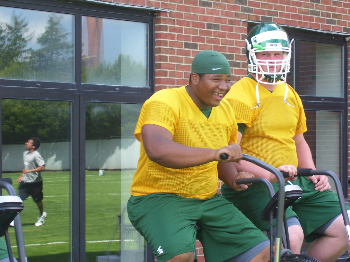 Here Ray is seen (above) while rehabbing in 2009, never lost his smile and positive attitude.  Photo courtesy of Mark Boomgaard.