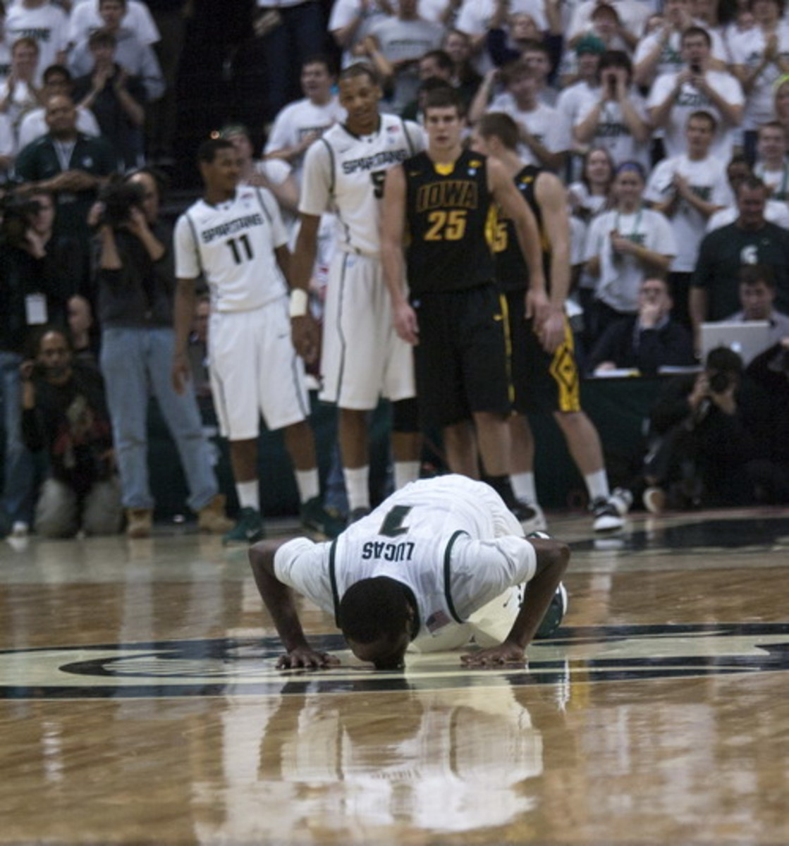 Surely Lucas deserves his jersey in the rafters at the Breslin.  Lucas is seen in the above picture kissing the Spartan at center court on his senior day.  Photo courtesy of Starr Portice.