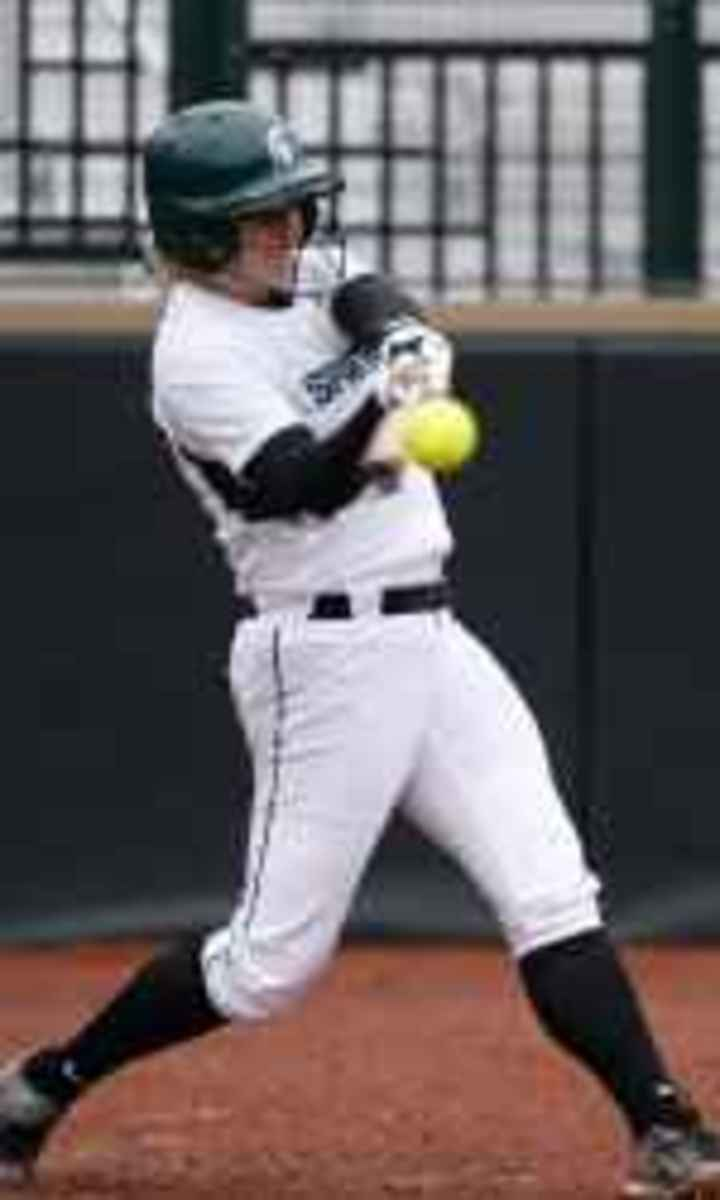 Sarah Bowling blasts game winning homer in game two.  Photo courtesy of MSU SID.