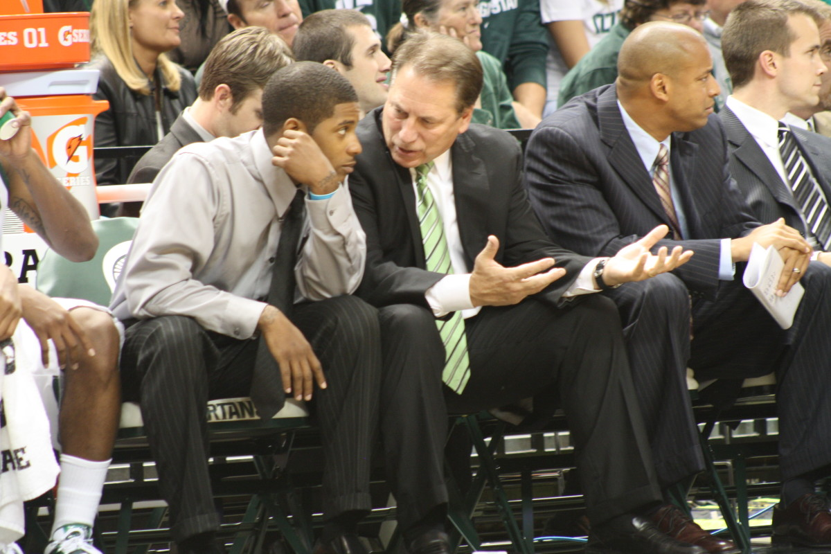 Tom Izzo took time tonight during the game to coach his suspended star guard Korie Lucious.  Photo courtesy of Mark Boomgaard.