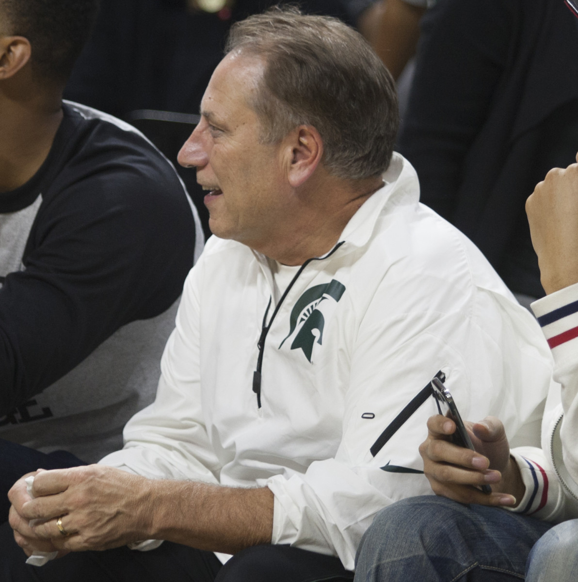 Tom Izzo takes a seat to watch some basketball activities.  Photo courtesy of Mark Boomgaard.