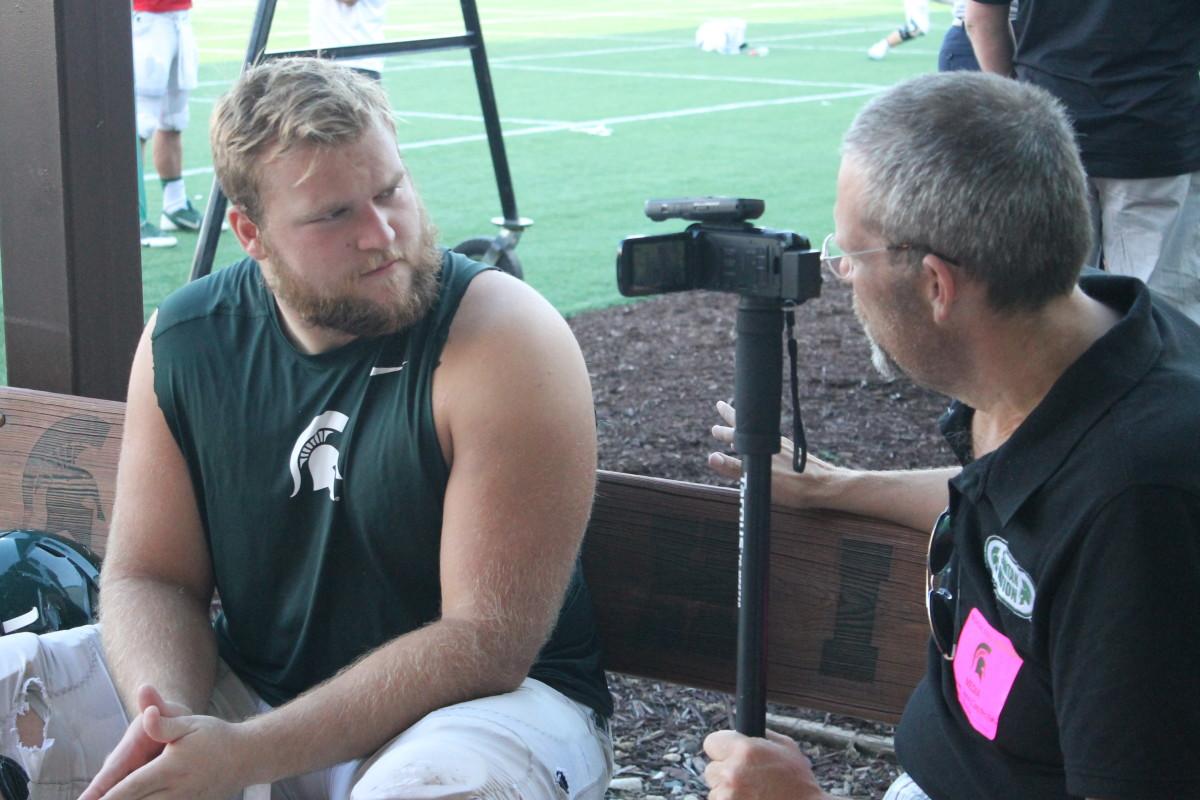Spartan OL Brian Allen and Hondo S. Carpenter, Sr. talk as the Spartans enter the last week of 2016 fall camp.