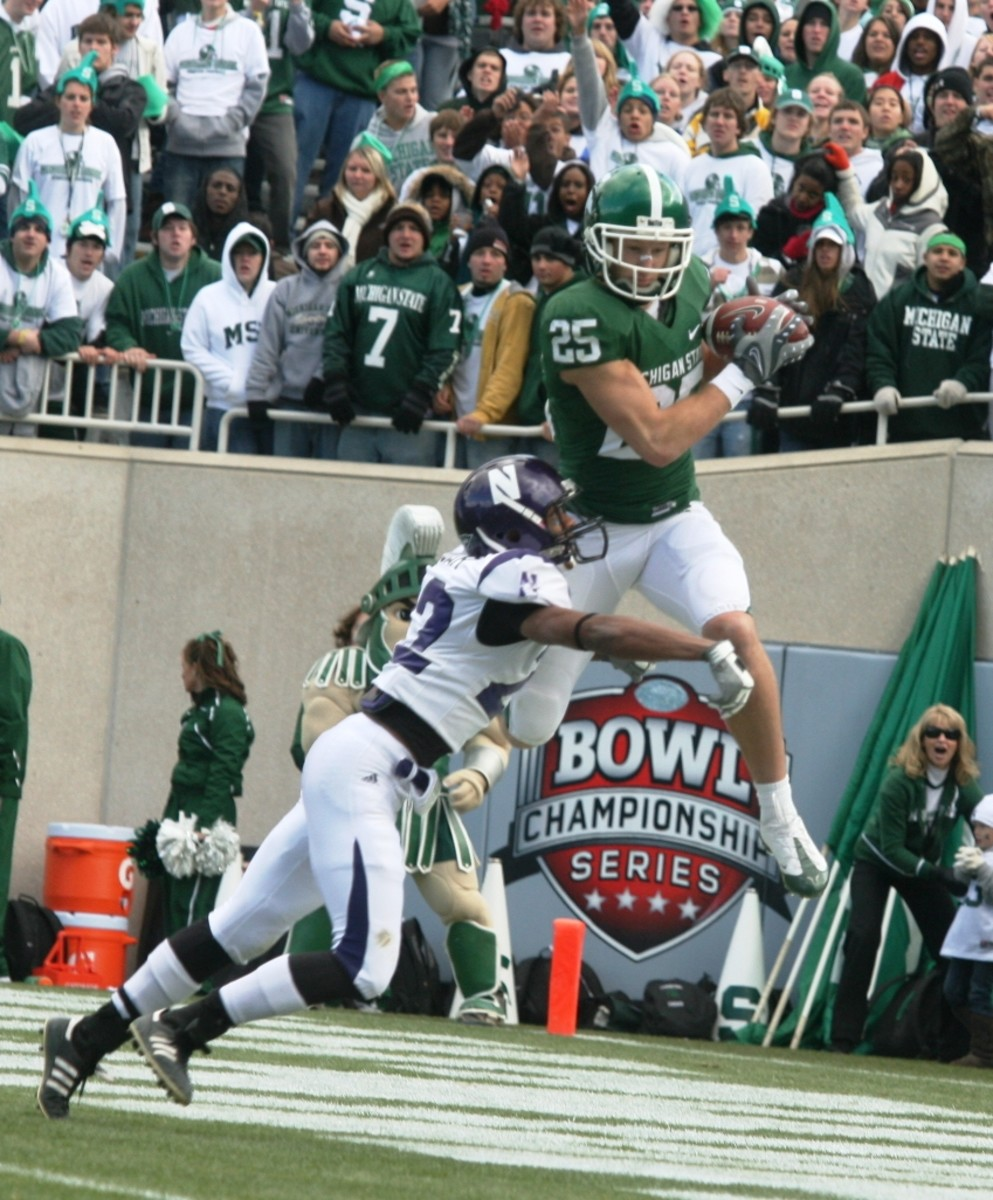 Go Green!  Blair White!  Here he is after an amazing third quarter TD.  Photo Courtesy of Bill Marklevits.