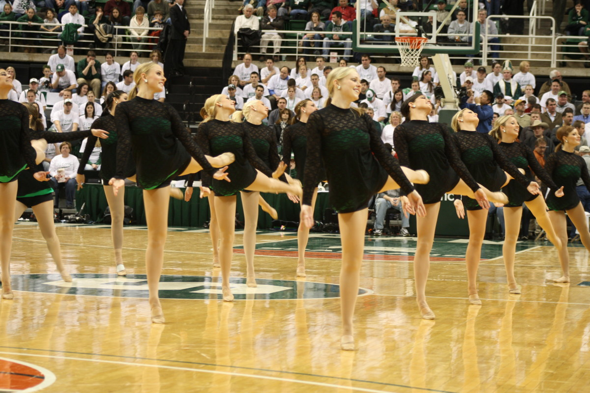 Not sure we want to see the Spartan Nation writing staff dancing like these ladies, but we can all agree that March is a time to celebrate Spartan Basketball.  Photo courtesy of Mark Boomgaard.