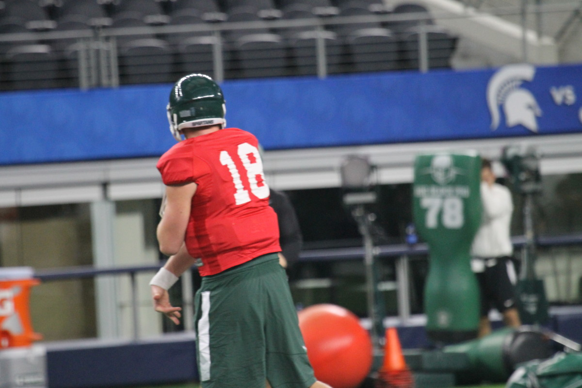 Connor Cook throwing a pass at Cotton Bowl Practice 12/28/15