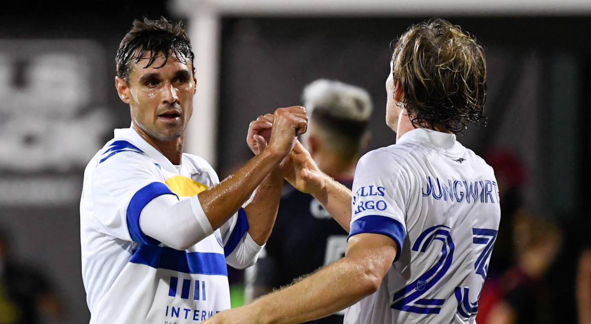 San Jose Earthquakes forward Chris Wondolowski (8) celebrates with midfielder Florian Jungwirth (23) after defeating the Chicago Fire during the first half at ESPN Wide World of Sports.
