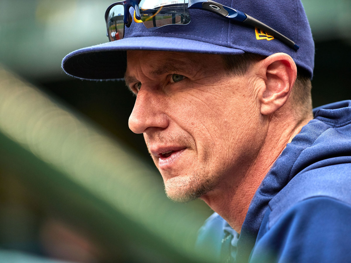 Close up of Craig Counsell in the dugout