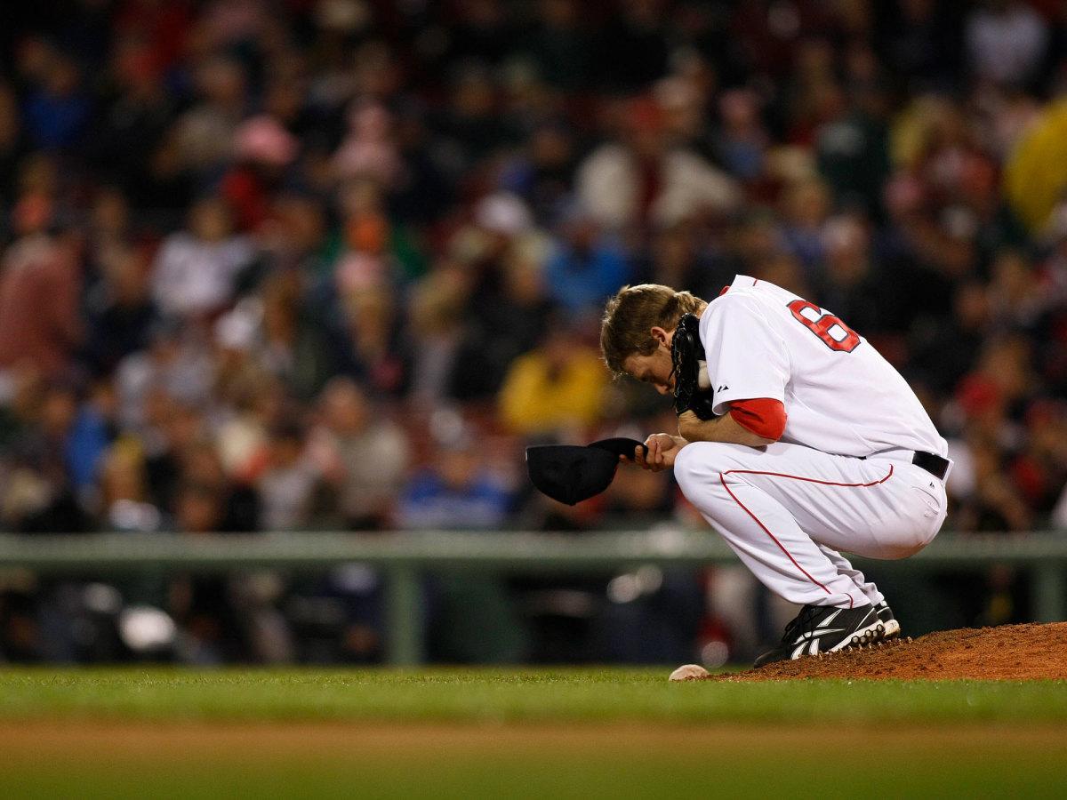 Daniel Bard crouching on the mound