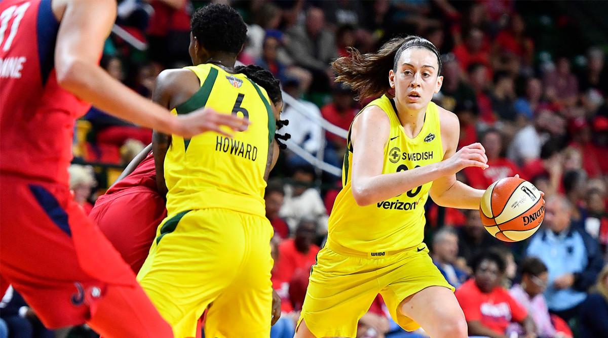 Breanna Stewart dribbles the ball