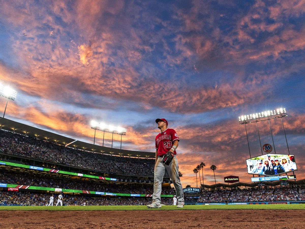 Mike Trout walking on a field