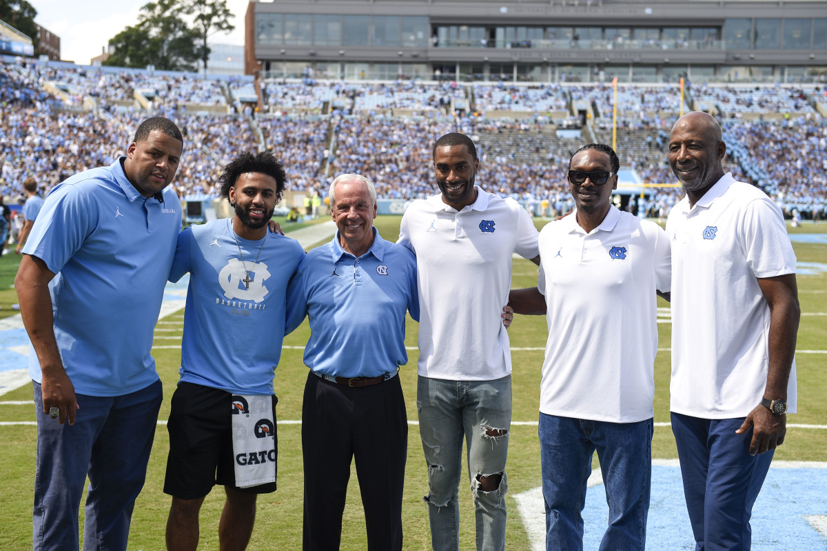North Carolina basketball players were honored with their 2017 National Championship rings at halftime at Kenan Memorial Stadium. Pictured here are five Final Four MVPs with Roy Williams.