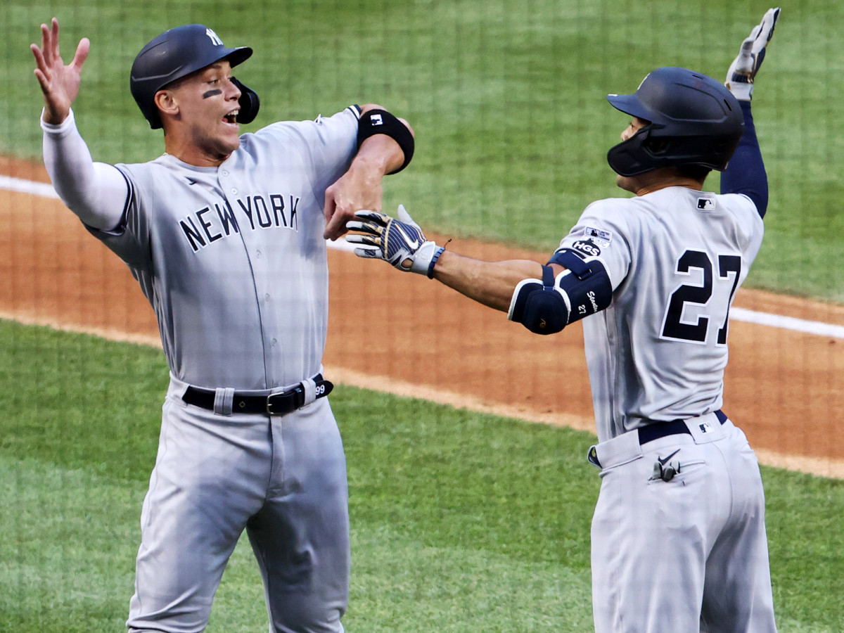 Jul 23, 2020; Washington, DC, USA;  New York Yankees designated hitter Giancarlo Stanton (27) celebrates with right fielder Aaron Judge (99) after hitting a two-run home run against the New York Yankees in the first inning during MLB Opening Day at Nationals Park.