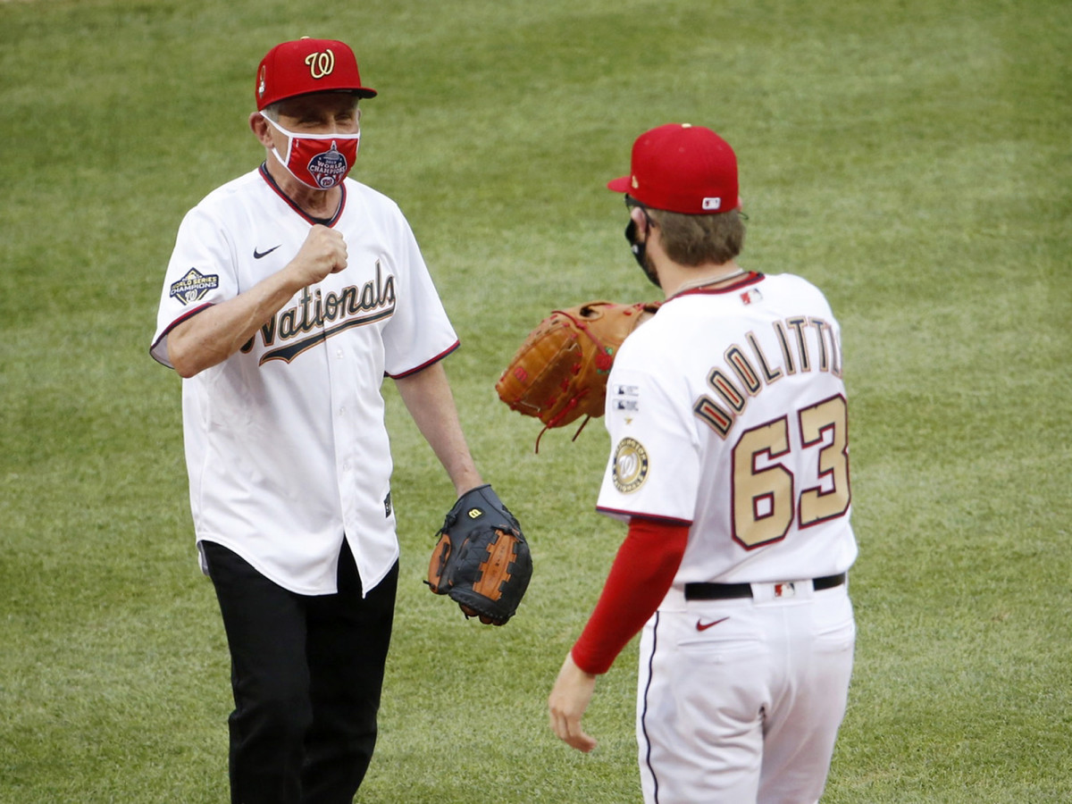 Jul 23, 2020; Washington, DC, USA; National Institute of of Allergy and Infectious Diseases director Dr. Anthony Fauci greets Washington Nationals relief pitcher Sean Doolittle (63) after throwing out the ceremonial first pitch before MLB Opening Day between the New York Yankees and the Washington Nationals at Nationals Park.
