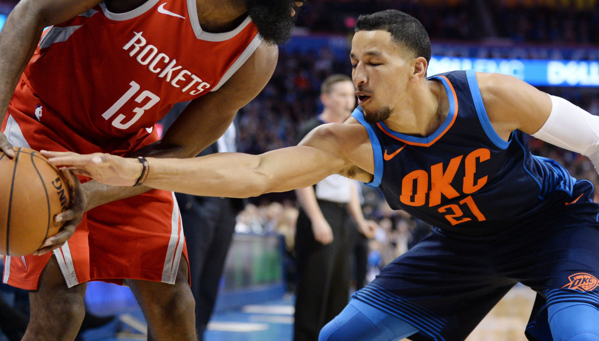 Oklahoma City Thunder guard Andre Roberson (21) attempts to steal the ball from Houston Rockets guard James Harden (13) during the second quarter at Chesapeake Energy Arena.
