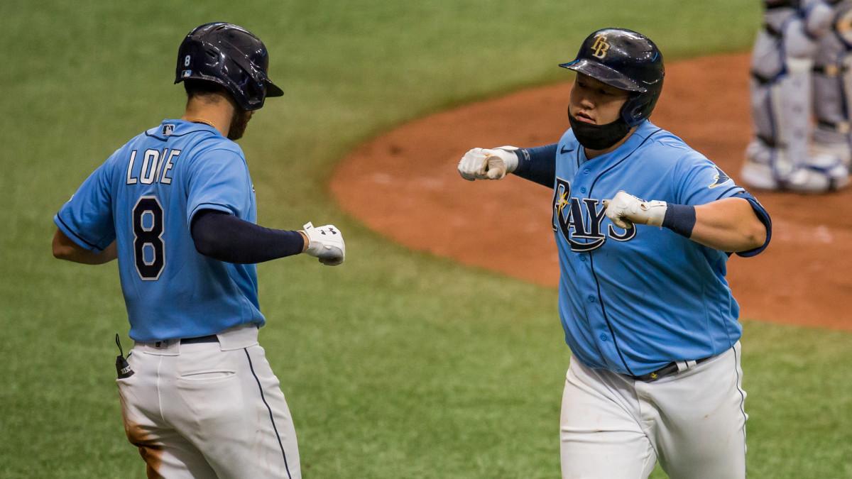 Rays' Ji-Man Choi crosses the plate after hitting a home run