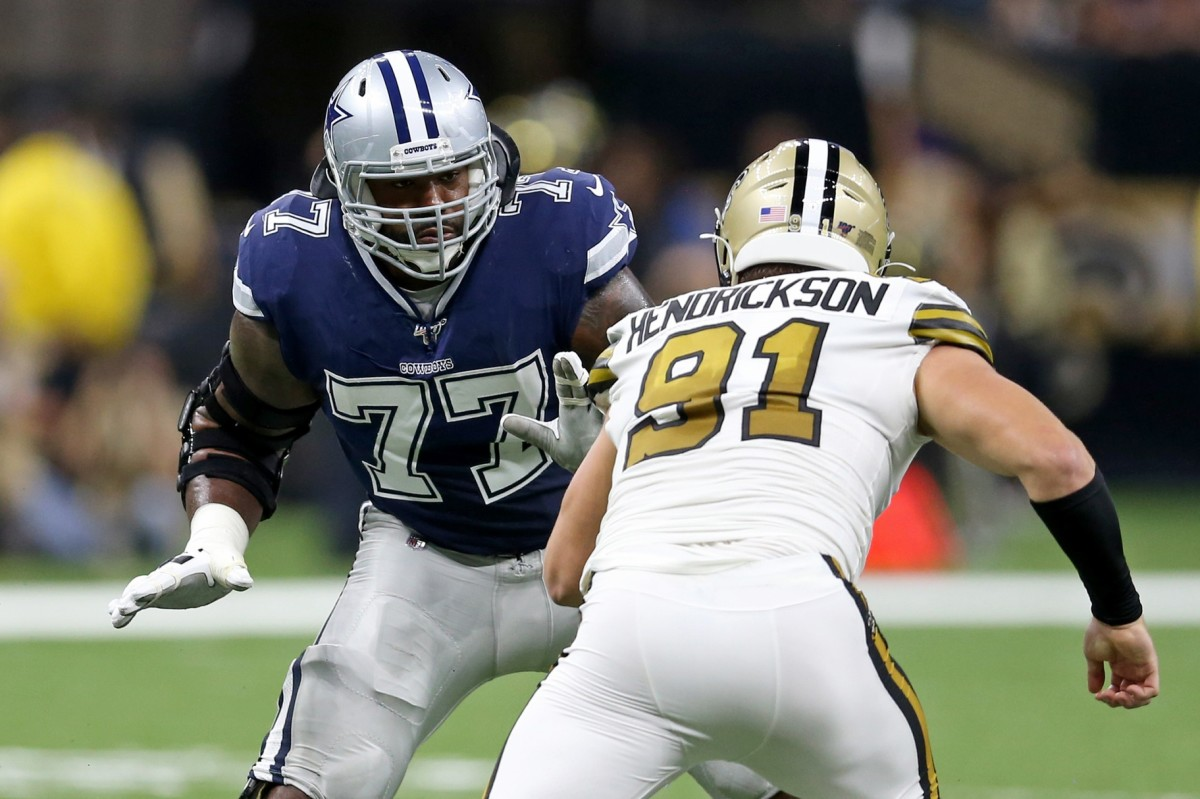 Sep 29, 2019; New Orleans, LA, USA; Dallas Cowboys offensive tackle Tyron Smith (77) blocks New Orleans Saints defensive end Trey Hendrickson (91) in the first quarter at the Mercedes-Benz Superdome. Mandatory Credit: Chuck Cook-USA TODAY Sports